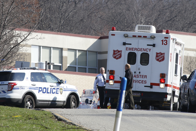 Emergency responders gather in the parking lot of the high school on the campus of the Franklin Regional School District where several people were stabbed at Franklin Regional High School on Wedne ...