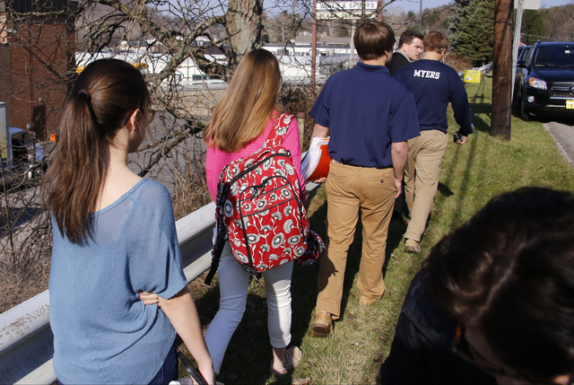 Students leave the campus of the Franklin Regional School District where several people were stabbed at Franklin Regional High School on Wednesday in Murrysville, Pa., near Pittsburgh. The suspect ...