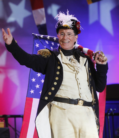 "This Aug. 10, 2012 file photo shows Stephen Colbert, host of ""The Colbert Report,"" onstage during StePhest Colbchella '012 Rocktaugustfest at the Intrepid Sea, Air & Space Museum in New York. CBS  ..."