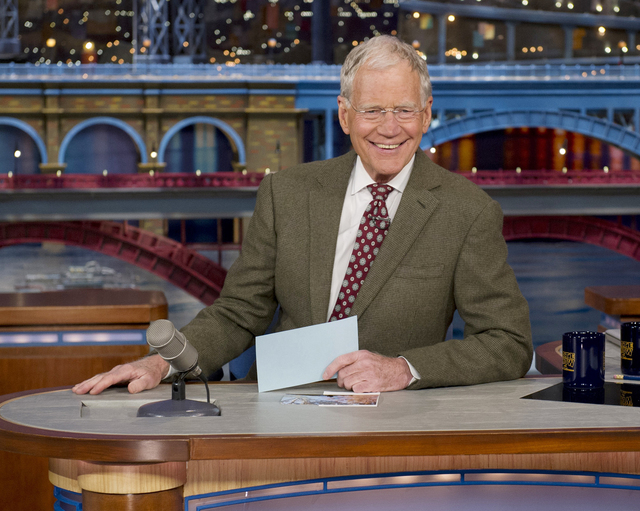 In this April 3, 2014 file photo provided by CBS, David Letterman, host of the Late Show with David Letterman, is seated at his desk in New York. Letterman has announced that he will retire in 201 ...