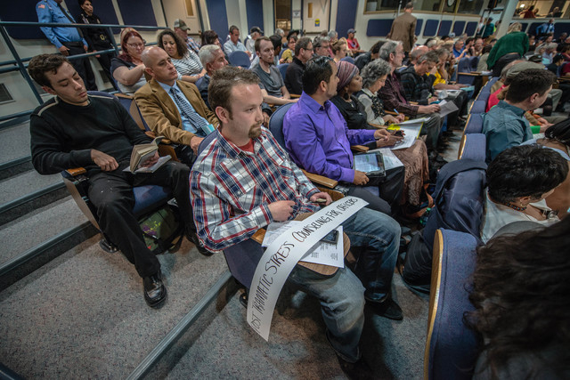Albuquerque resident Davin Poulin, center, signed up to speak before the city council Monday evening, April 7, 2014, in Albuquerque, N.M. (AP Photo/Albuquerque Journal, Roberto Rosales)