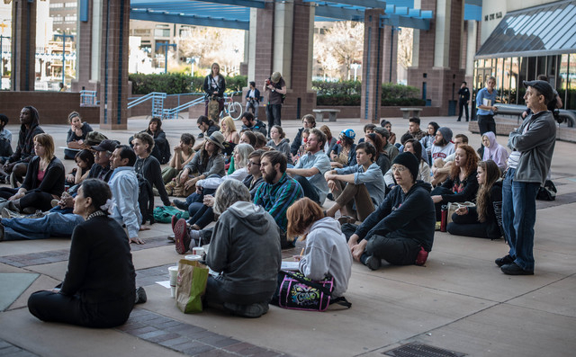 An overflow crowd watches the City Council meeting outside City Hall Monday evening, April 7, 2014, in Albuquerque, N.M. (AP Photo/Albuquerque Journal, Roberto Rosales)
