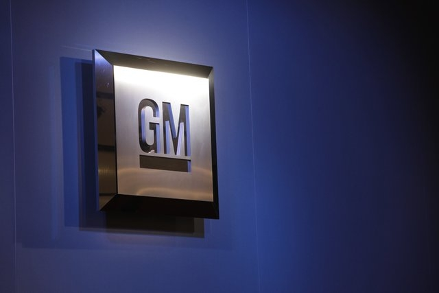 FILE - In this Jan. 12, 2009, file photo, the General Motors logo is seen on display at the North American International Auto Show in Detroit. The National Highway Traffic Safety Administration is ...