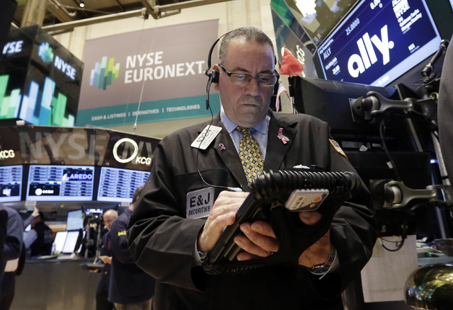 Trader John Yaccarine works on the floor of the New York Stock Exchange Thursday, April 10, 2014.  U.S. stock indexes are slipping lower in early trading Thursday as investors pick over a mixed ba ...