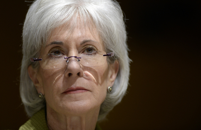 Health and Human Services Secretary Kathleen Sebelius listens as she testifies on Capitol Hill in Washington, Thursday, April 10, 2014, before the Senate Finance Committee hearing on the HHS Depar ...