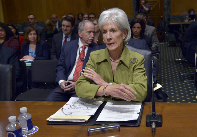 Health and Human Services Secretary Kathleen Sebelius prepares to testify on Capitol Hill in Washington, Thursday, April 10, 2014, before the Senate Finance Committee hearing on the HHS Department ...