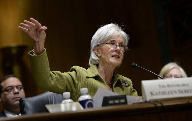 Health and Human Services Secretary Kathleen Sebelius testifies on Capitol Hill in Washington, Thursday, April 10, 2014, before the Senate Finance Committee hearing on the HHS Department's fiscal  ...