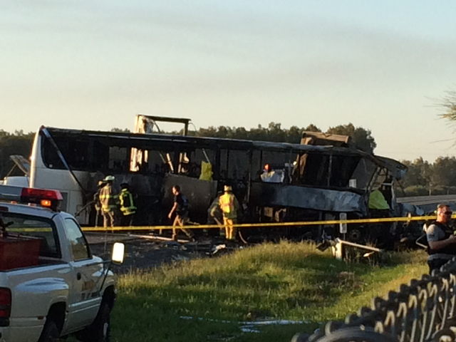 Authorities work the scene where 10 people were killed in a three-vehicle crash involving a bus carrying high school students on a visit to a college, Thursday near Orland, Calif. Authorities say  ...