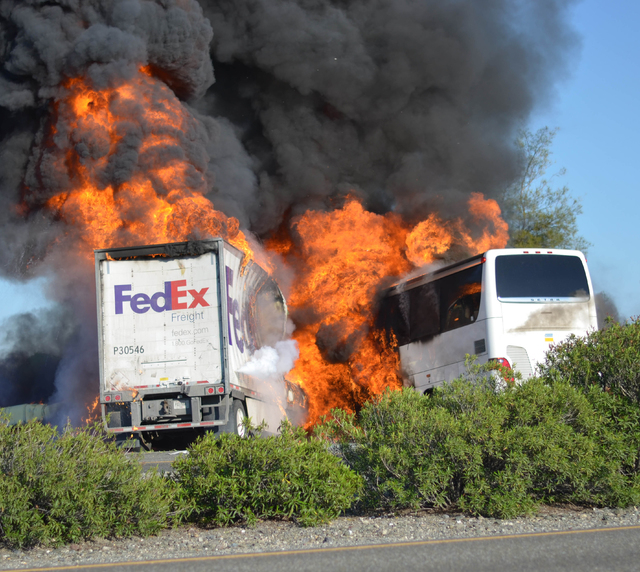 Massive flames are seen devouring a FedEx tractor-trailer and a bus just after the crash on Thursday until firefighters had quenched the fire, leaving behind scorched black hulks of metal. The Fed ...