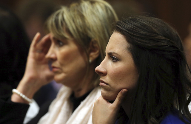Aimee Pistorius, right, sister of Oscar Pistorius, listens in the public gallery, as state prosecutor Gerrie Nel questions Pistorius in court in Pretoria, South Africa, Friday, April 11, 2014. The ...