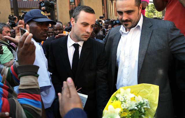 Oscar Pistorius leaves the high court in Pretoria, South Africa, Friday, April 11, 2014. Pistorius is charged with the murder of his girlfriend Reeva Steenkamp, on Valentines Day in 2013. (AP Phot ...