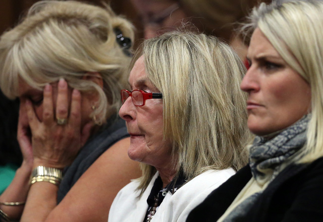 June Steenkamp, center, mother of the late Reeva Steenkamp, listens in the public gallery, as state prosecutor Gerrie Nel questions Oscar Pistorius, in court in Pretoria, South Africa,  Friday, Ap ...