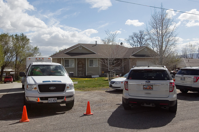 Authorities investigate a crime scene at a house in Pleasant Grove Utah,  Sunday, April 13, 2014. According to the Pleasant Grove Police Department, seven dead infants were found in the former hom ...