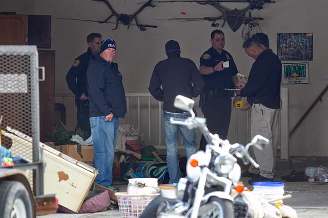Authorities investigate a crime scene at a house in Pleasant Grove, Utah,  Sunday, April 13, 2014.  According to the Pleasant Grove Police Department, seven dead infants were found in the former h ...