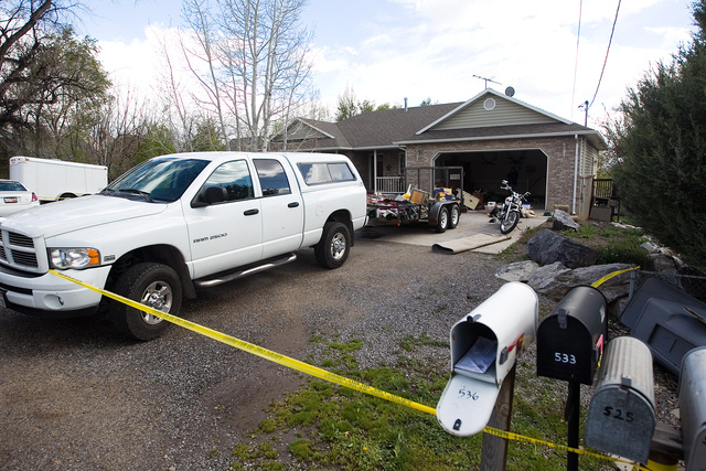 Authorities investigate a crime scene at a house in Pleasant Grove Utah, Sunday, April 13, 2014. According to the Pleasant Grove Police Department, seven dead infants were found in the former home ...