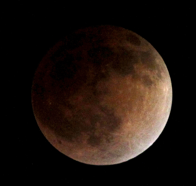"""As the moon completely crosses the earth's shadow, the first of four total lunar eclipses this year and next, called the """"blood moon,"""" occur in Whittier, Calif., on Tuesday, April 15, 2014. (AP Ph ..."""