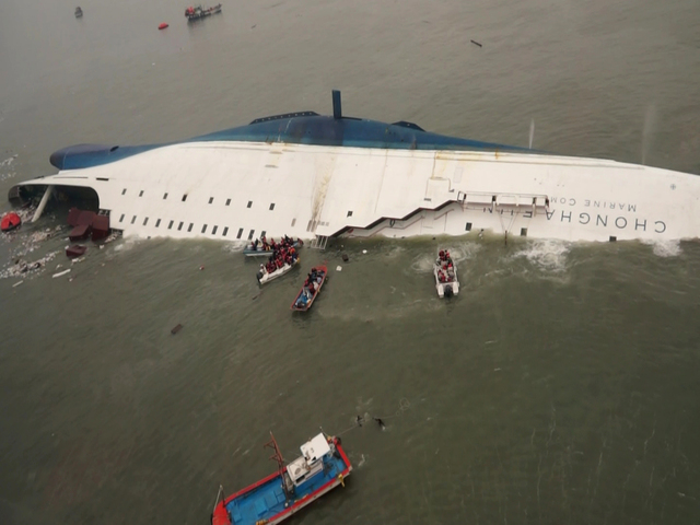South Korean rescue team boats and fishing boats try to rescue passengers of a ferry sinking off South Korea's southern coast, in the water off the southern coast near Jindo, south of Seoul, Wedne ...