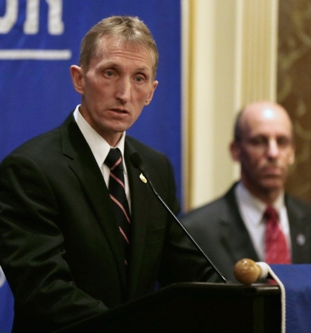 Boston Police Commissioner William Evans speaks during a news conference in preparation for the Boston Marathon as Massachusetts Emergency Management Agency Director Kurt Schwartz, right, listens, ...