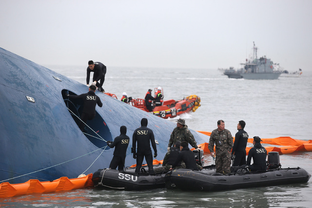 South Korean rescue team members search for passengers aboard a ferry sinking off South Korea's southern coast, in the water off the southern coast near Jindo, south of Seoul, South Korea, Thursda ...