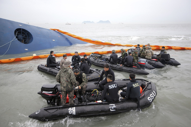 South Korean rescue team members prepare to search for passengers of a ferry sinking off South Korea's southern coast, in the water off the southern coast near Jindo, south of Seoul, South Korea,  ...