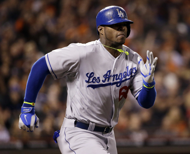 Los Angeles Dodgers' Yasiel Puig runs to first base as he grounds out during the eighth inning of a April 16 game in San Francisco. (AP Photo/Marcio Jose Sanchez)