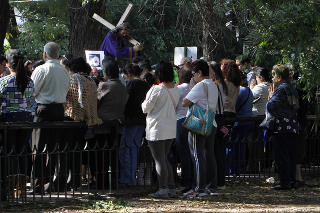 People who were participating in a Holy Week procession stop and pray after a strong earthquake jolted Mexico City, Friday, April 18, 2014. A powerful magnitude-7.2 earthquake shook central and so ...