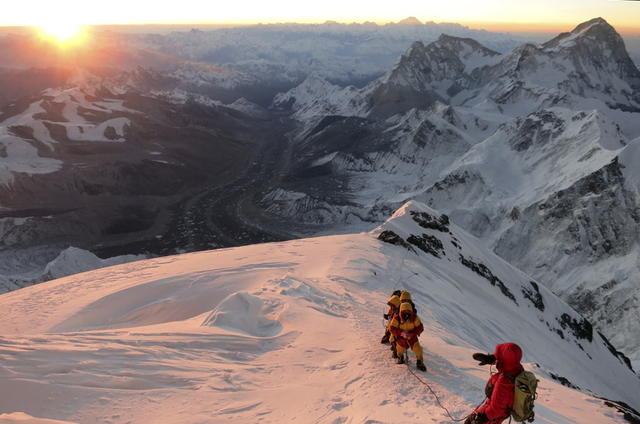 Climbers make their way to the summit of Mount Everest on May 18, 2013, in the Khumbu region of the Nepal Himalayas. An avalanche swept down a climbing route on Mount Everest early Friday, April 1 ...