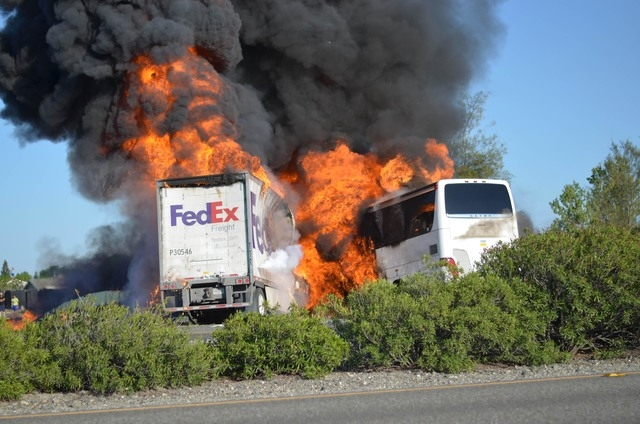 Massive flames engulf a tractor-trailer and a tour bus just after they collide on Interstate 5 near Orland, Calif. Authorities are releasing 911 calls made after a FedEx struck slammed into a tour ...