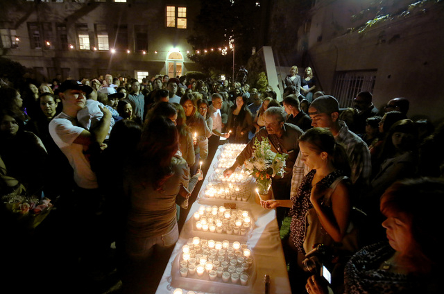 "Family, friends and colleagues of Arthur ""Tury"" Arzola, Jr. gathered for a memorial service and candlelight vigil on Wednesday April 16, 2014. The University of La Verne graduate student was one o ..."
