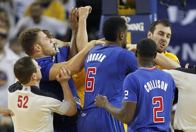 In this Dec. 25, 2013, file photo, Los Angeles Clippers power forward Blake Griffin, left, fights with Golden State Warriors center Andrew Bogut, right, as Clippers center DeAndre Jordan (6) and D ...