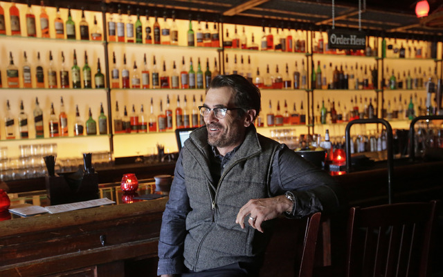 In this April 16, 2014 photo, actor Ty Burrell, who plays bumbling dad Phil Dunphy on ABC's Modern Family, sits at the bar at Bar X, the cocktail bar he co-owns, in Salt Lake City. Burrell just op ...