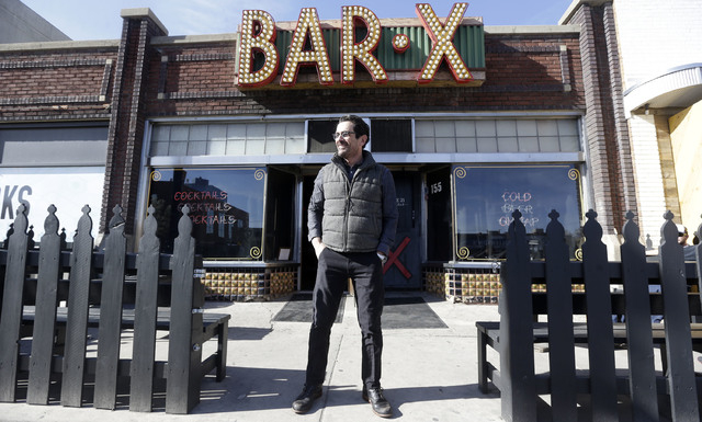 In this April 16, 2014 photo, actor Ty Burrell, who plays bumbling dad Phil Dunphy on ABC's Modern Family, stands outside Bar X, the cocktail bar he co-owns, in Salt Lake City. Burrell just opened ...