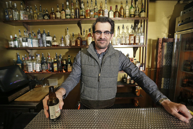 Actor Ty Burrell, who plays bumbling dad Phil Dunphy on ABC's Modern Family, poses holding a beer at Bar X, the cocktail bar he co-owns, in Salt Lake City. Burrell just opened Beer Bar, a beer gar ...