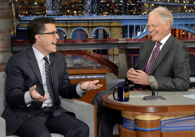 """On May 3, 2012 Stephen Colbert, left, host of the """"Colbert Report"""" on the Comedy Central Network, has a laugh on stage with host David Letterman on the set of the """"Late Show"""" with David Letterman, ..."""