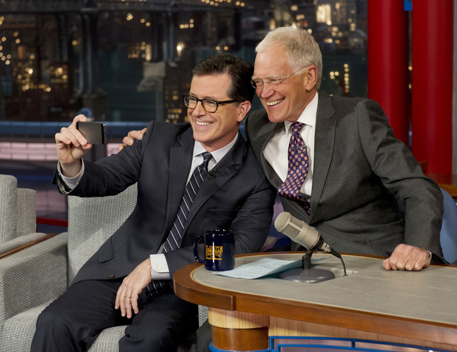 """On May 3, 2012 Stephen Colbert, left, host of the """"Colbert Report"""" on the Comedy Central Network, takes a 'selfie' with host David Letterman on the set of the """"Late Show"""" with David Letterman, in  ..."""