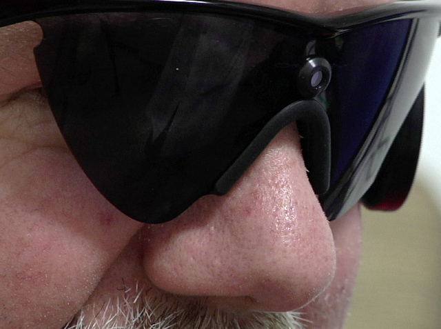 In this April 16, 2014 image from video Roger Pontz wears special glasses that house a small video camera and transmitter at the University of Michigan Kellogg Eye Center on April 16, 2014, in Ann ...