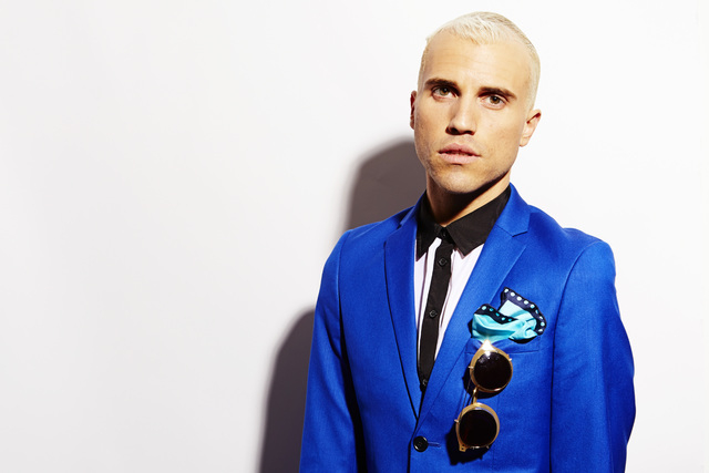 "Tyler Glenn, frontman of the band Neon Trees, poses for a portrait to promote the band's upcoming third album, ""Pop Pyschology,"" on Tuesday, April 22, 2014 in New York. (Photo by Dan Hal ..."