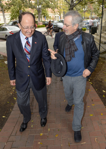 This image provided by the University of Southern California shows director Steven Spielberg, right, with USC President C.L. Max Nikias, making their way to the USC Shoah Foundation's announcement ...