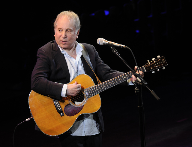 "FILE - This April 2, 2012 file photo shows singer Paul Simon performing at ""A Celebration of Paul Newman's Dream"" to benefit ""SeriousFun"" an association of Hole in the Wall Cam ..."