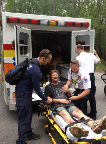 In this photo made available by the National Park Service,  JR Kimber receives medical assistance at Congaree National Park in Hopkins, S.C., Tuesday, April 29, 2014. Kimber and his two  children  ...