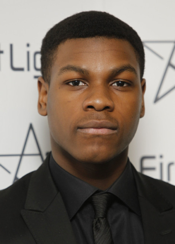 FILE - In this March 5, 2012 file photo, British actor John Boyega stands for photos after he presented the First Light Awards, in London. The cast of Star Wars: Episode VII was announced Tuesday, ...