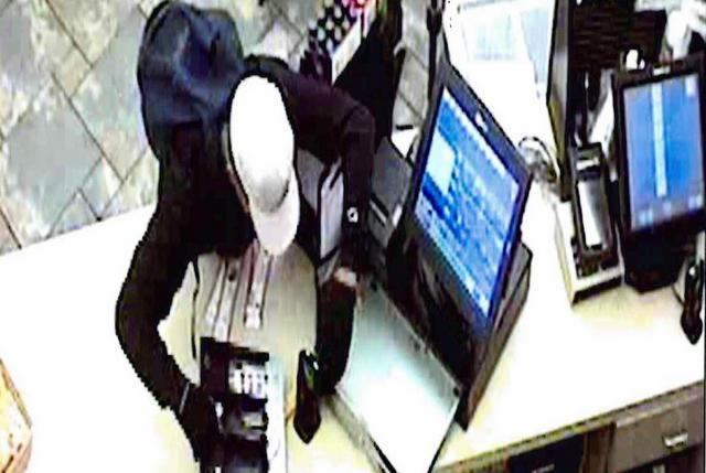 Police are looking for two suspects in a Feb. 17 robbery at a convenience store was robbed in the area of South Buffalo and Peace Way. One of the suspects is seen in these images from security cam ...