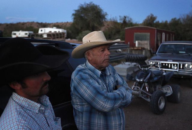 "Cliven Bundy, right, and Clance Cox, left, stand at the Bundy ranch near Bunkerville on Saturday. The Bureau of Land Management has begun to round up what they call ""trespass cattle"" that rancher  ..."