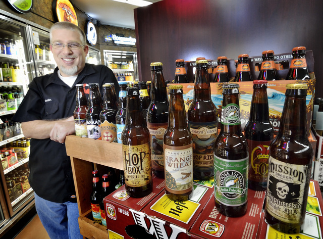 Mark Lawson, craft brand manager with Nevada Beverage Company, is shown with a selection of craft beers at White Cross Market, 1700 Las Vegas Blvd. South, on March 6. (Bill Hughes/Las Vegas Review ...