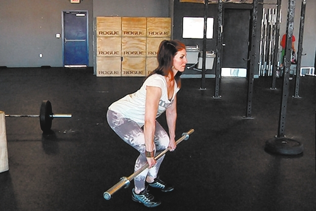 Ending position for barbell deadlift complex with Laura Salcedo at Cross Fit Mountain's Edge on Wednesday March 19, 2014. (Michael Quine/Las Vegas Review-Journal)