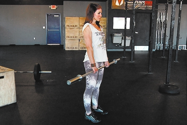 Starting position for barbell deadlift complex with Laura Salcedo at Cross Fit Mountain's Edge on Wednesday March 19, 2014. (Michael Quine/Las Vegas Review-Journal)