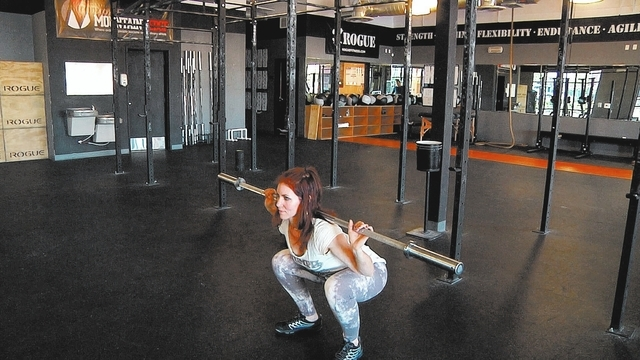 Ending position for barbell squat complex with Laura Salcedo at Cross Fit Mountain's Edge on Wednesday March 19, 2014. (Michael Quine/Las Vegas Review-Journal)