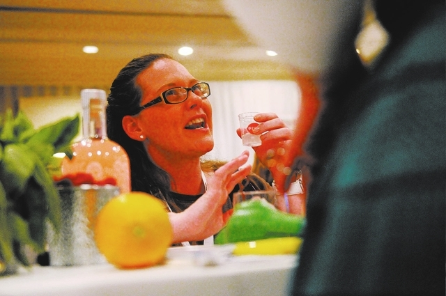 Barbara Stanley, left, tries the Limoncello Pink liqueur at the LiDestri Spirits booth during the Wine & Spirits Wholesalers of America's 71st annual convention at the Caesars Palace casino-hotel  ...