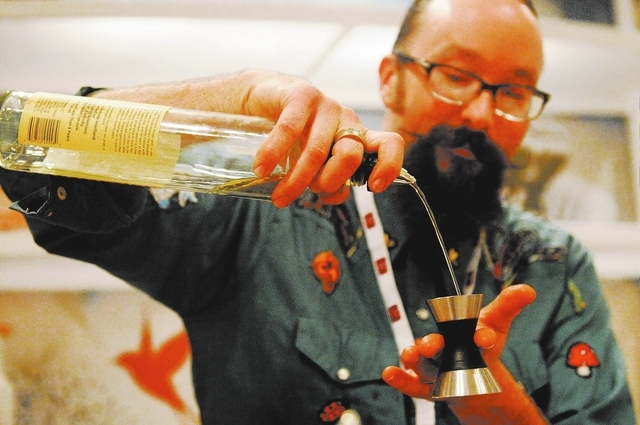 Adam Rains mixes drinks for LiDestri Spirits at their booth during the Wine & Spirits Wholesalers of America's 71st annual convention at the Caesars Palace casino-hotel in Las Vegas Tuesday, April ...
