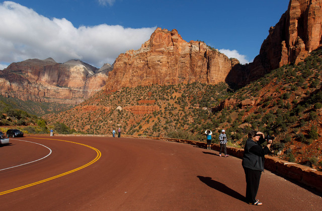 Visitors to Zion National Park take in the sights.  (AP Photo/The Salt Lake Tribune, Trent Nelson)